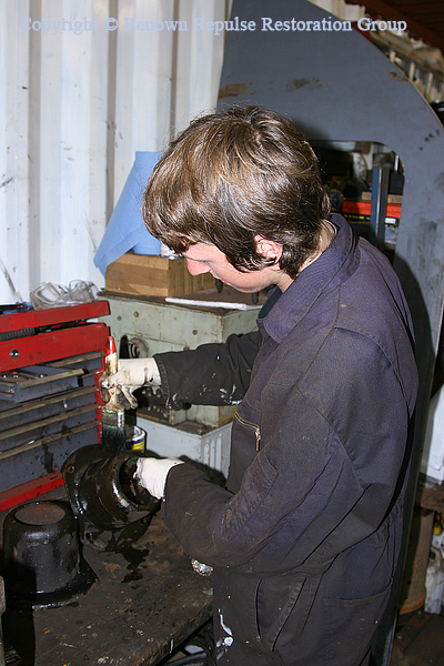 Chris Bodell painting a brake cylinder cap