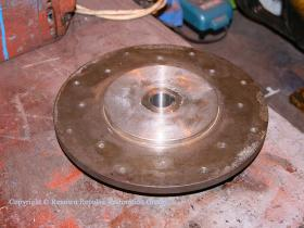 Fan centre plate from traction motor blower