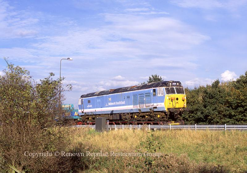 50029 at junction 14 of the M1 moving to Peak Rail in October 2002